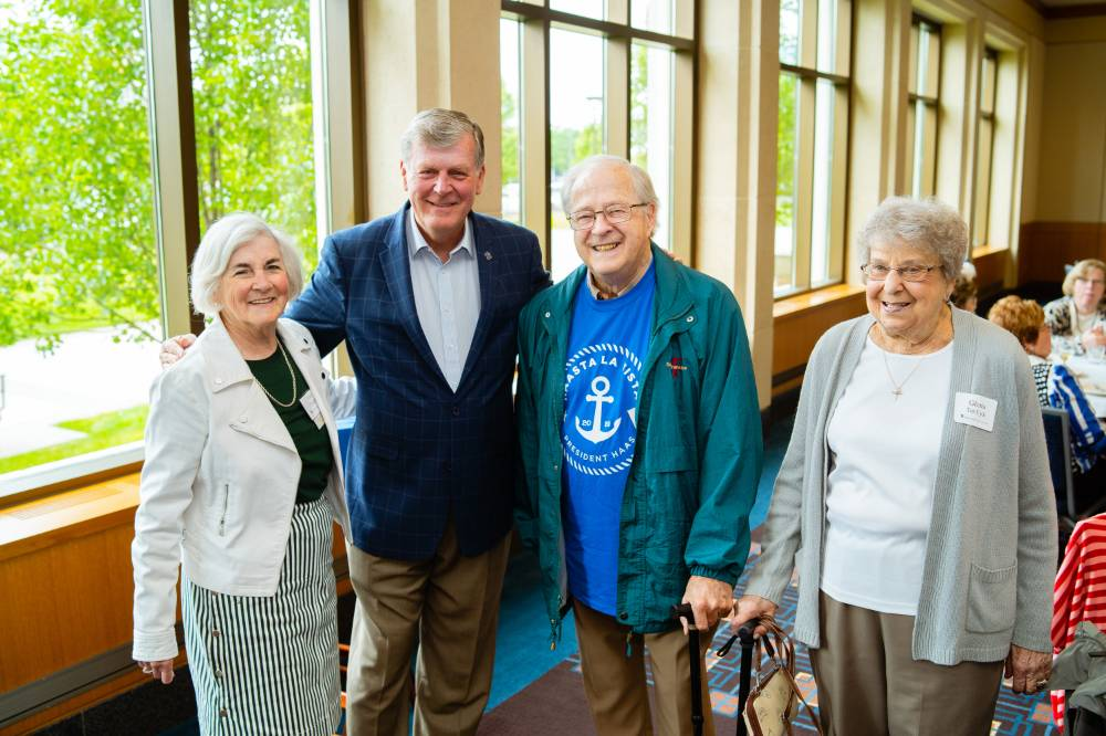 President Haas posing with guests at the Retiree Reception.